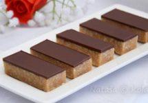 Prăjitură cu nucă de cocos și glazură de ciocolată – un desert delicios, ușor de pregătit